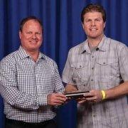 Steve Waletzko and Dan Tompkins accept the 2017 PPAI Pyramid Award on behalf of E Group, Inc.